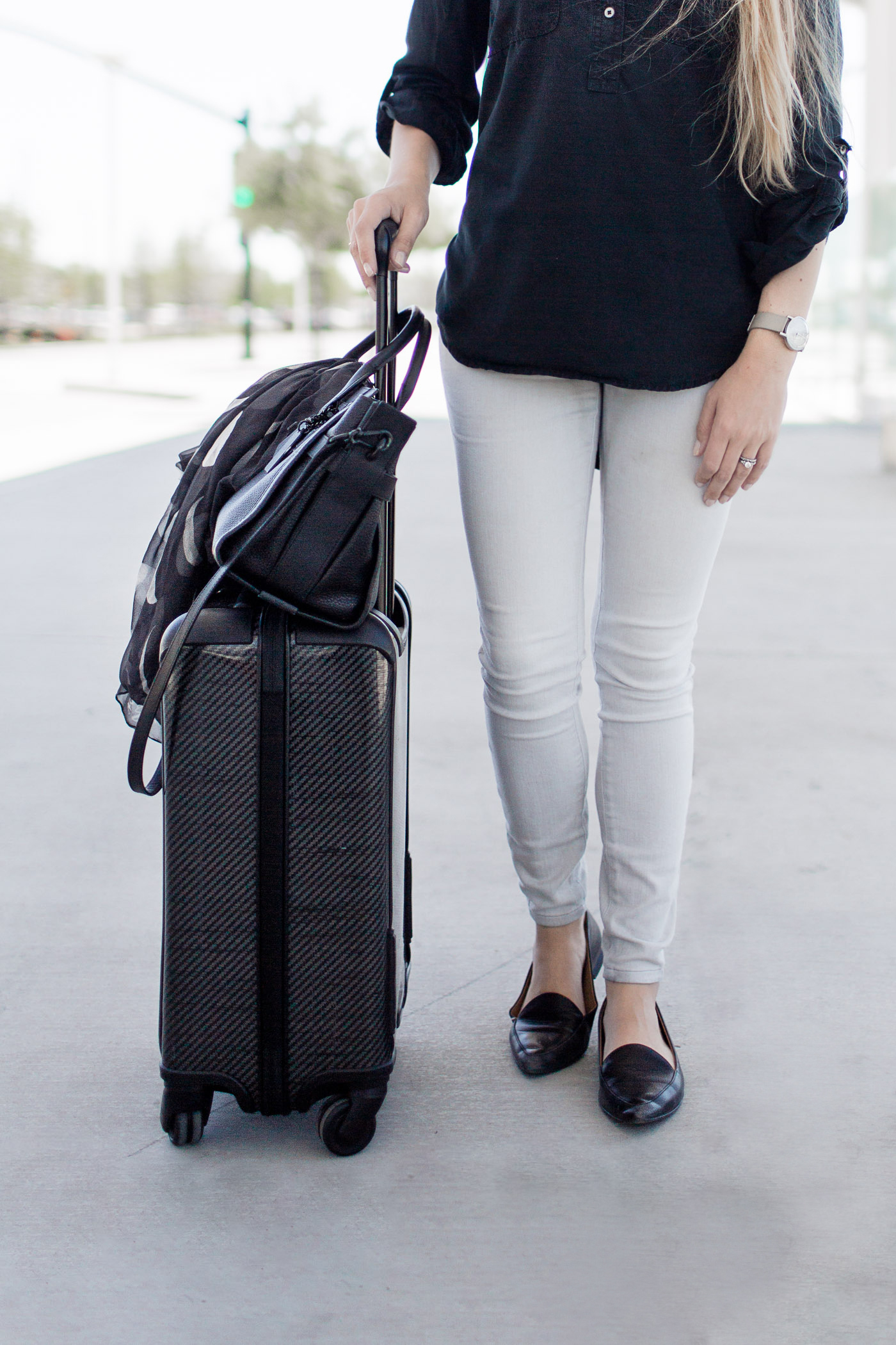 My go-to airport travel outfit, featuring Lou & Grey, Tumi, Everlane, & Coach.